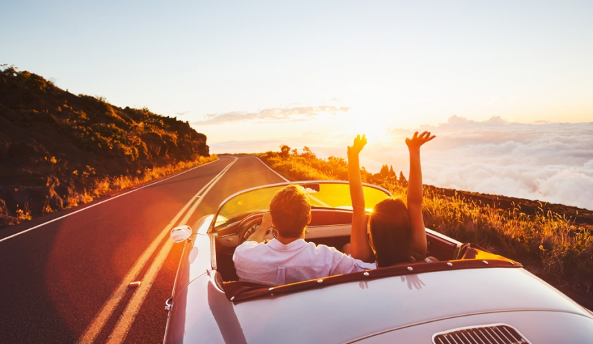 Honeymoon-Couple-Driving-Sunset-Mountains-California-Trip-Domestic-Local-Affordable-Travel-Specialist